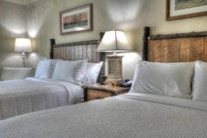 Spacious room with queen beds at The Lodge at Five Oaks hotel in Sevierville Tn